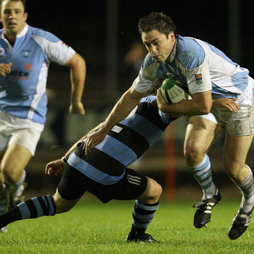 Garryowen centre Kevin Hartigan is tackled by Shannon captain Mossie Lawlor