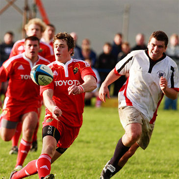 Ronan O'Mahony flings a pass out for the Munster Academy side
