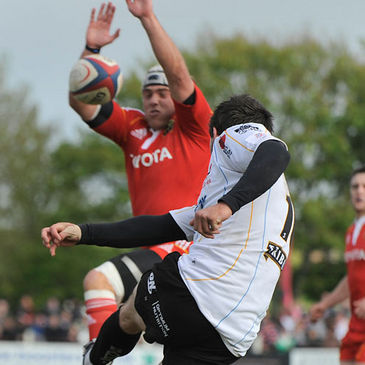 Duncan Williams blocks a kick from Pirates number 10 Jonathan Bentley