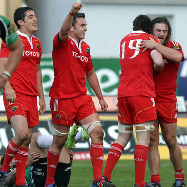 The Munster players celebrate their win over Connacht