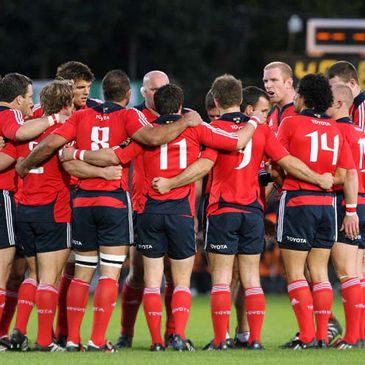 The Munster players huddle around Paul O'Connell