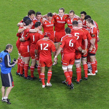 The Munster players huddle together