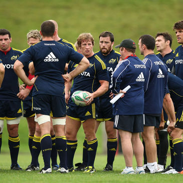 The Munster players huddle together at training