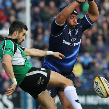 Leinster prop Stan Wright tries to block down Frank Murphy's kick