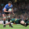 Northampton's Ben Foden goes low as he attempts to tackle Leinster's Scotland-capped second row Nathan Hines