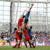 Leinster's Scotland lock Nathan Hines stretches for a lineout ball above Toulouse's Yoann Maestri