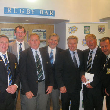 Caleb Powell, Kevin Fitzpatrick and Mícheál Ó Muircheartaigh with Navan club personnel