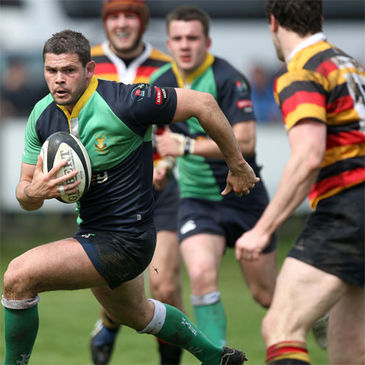 Ballynahinch hooker Neil Hanna charges through against Lansdowne