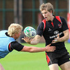 Former Ireland Under-20 international Nevin Spence puts pressure on Andrew Trimble during Monday's session