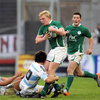 Scrum half John Cooney is quickly on the scene as Ireland centre Nevin Spence has his progress halted