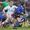Bath's replacement hooker Pieter Dixon is closed down by Ballynahinch clubman and Ireland Under-20 starlet Nevin Spence