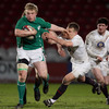 Ireland Under-20 centre Nevin Spence tries to fend off England's Sam Harrison as he goes on a break