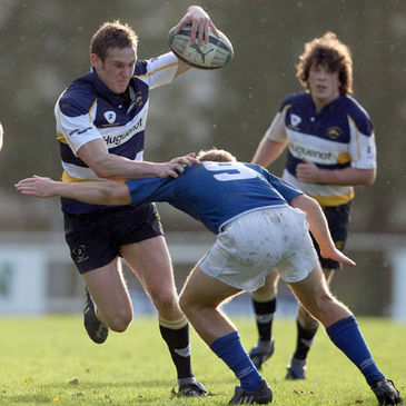 Dolphin winger Niall O'Driscoll tries to get past Joe Burns