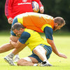 Niall Ronan brings down Alan Cotter, the Young Munster prop who has impressed for Munster 'A' in recent seasons