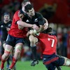 New Zealand number 10 Stephen Donald has nowhere to go as Munster's Donnacha Ryan and Niall Ronan tackle him