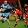 Cardiff's Gareth Thomas gets a rare chance to stretch his legs, with Niall Ronan in hot pursuit