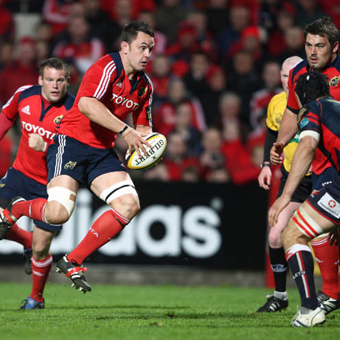 Niall Ronan takes the ball on for Munster