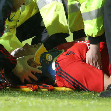 Niall Ronan was fitted with a neck brace on the pitch