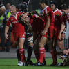 Munster's two-try flanker Niall Ronan is congratulated by Peter Stringer and Doug Howlett after scoring his second try