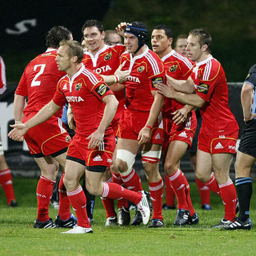 Try scorer Niall Ronan is congratulated by his Munster team-mates
