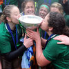 Backs Niamh Briggs and Larissa Muldoon plant kisses on the prized piece of silverware which will have an Irish home for the next year