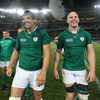 The smiling Donncha O'Callaghan and Paul O'Connell make their way off the Eden Park pitch after Ireland's first ever World Cup victory over Australia