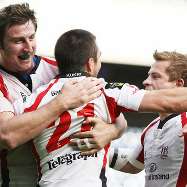 Ed O'Donoghue and Paul Marshall congratulate Ulster try scorer Ian Humphreys