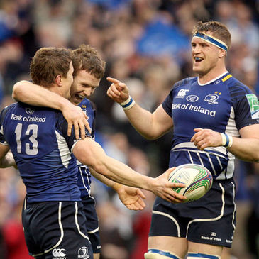 Gordon D'Arcy and Jamie Heaslip celebrate with try scorer Brian O'Driscoll