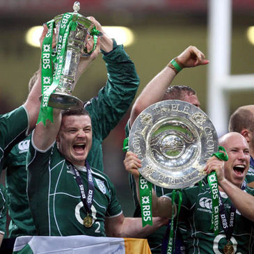 Brian O'Driscoll and Peter Stringer hold the trophies aloft