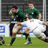 Ireland number 8 Paddy Butler tries to find a way past English replacement Calum Green