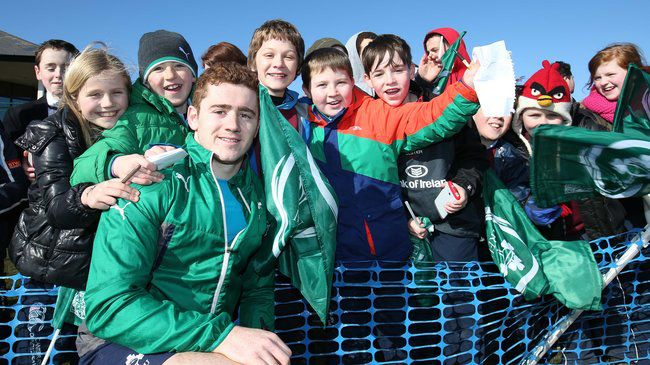 Paddy Jackson poses with some young Ireland fans