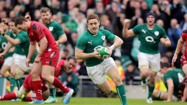 Paddy Jackson is pictured running in his first try for Ireland