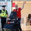 Paddy 'Rala' O'Reilly, the much-loved baggage master for the Ireland and Lions squads, waves to the waiting crowd in Terminal 2