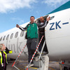 Paddy Wallace gestures to Inpho photographer Dan Sheridan as the players step off the airplane following their flight from New Plymouth