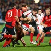 Munster captain Mick O'Driscoll tries to wrap up Paddy Wallace as the Ulster centre snipes through