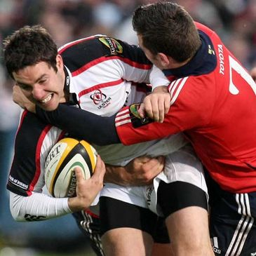 Ulster's Paddy Wallace is tackled by Munster flanker Niall Ronan