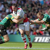 Paddy Wallace grimaces as he is tackled by two Northampton players, including his former Ulster team-mate Roger Wilson