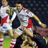 Ulster's Paddy Wallace, who started at out-half, is stopped in his tracks by Edinburgh flanker Ross Rennie