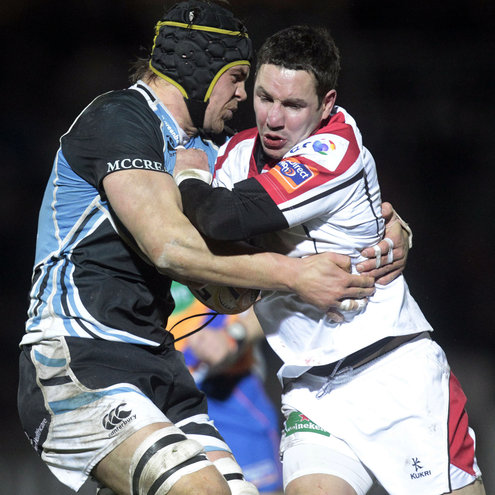 Paddy Wallace is tackled by Glasgow's Tom Ryder