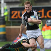 Connacht winger Liam Bibo tries to shrug off a tackle from Northampton's Paul Diggin