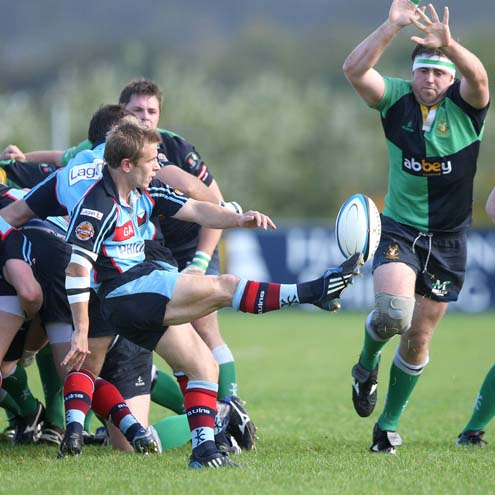 Paul Marshall gets his kick away for Belfast Harlequins