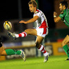 Ulster scrum half Paul Marshall dinks a kick through, with his opposite number, Connacht's Frank Murphy, close by