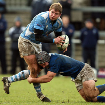 Garryowen try scorer Paul Neville is tackled by Hugh Hogan of St. Mary's