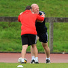 Strength & conditioning coach Joe Gallanagh assists Paul O'Connell as he does some stretching exercises