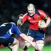Munster's Paul O'Connell prepares to take a tackle from Leinster hooker Bernard Jackman