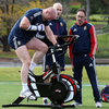 Dr. Eanna Falvey and sports scientist Brian Cunniffe monitor the progress of Paul O'Connell as he does some fitness work on a bike