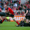 Munster captain Paul O'Connell leaves Marty Holah in his wake as he powers into a tackle from Ospreys full-back Gareth Owen