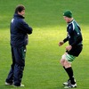 Forwards coach Gert Smal has a word with Paul O'Connell as the Munster captain tests out his dead leg injury