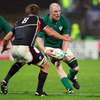 Ireland's pack leader Paul O'Connell prepares to pass the ball, with American number 8 Nic Johnson closing him down