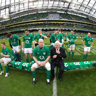 Paul O'Connell gets ready for the squad photo alongside IRFU President John Hussey